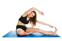 Fitness woman stretching on gym mat Royalty Free Stock Photo