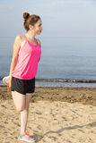 Fitness woman stretching her hips during outdoor workout Stock Photography