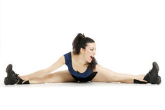 Fitness woman stretching her leg to warm up Stock Images