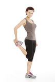 Fitness woman stretching her leg to warm up Royalty Free Stock Photos