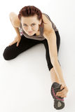 Fitness woman stretching her leg to warm up Royalty Free Stock Photography