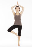 Fitness woman stretching her leg to warm up Stock Photo