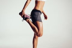 Fitness woman stretching her legs Royalty Free Stock Images