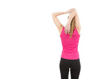 Fitness woman stretching her shoulders stock image