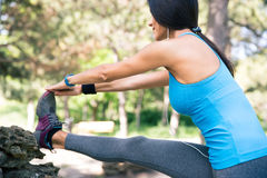 Fitness woman stretching legs in park Royalty Free Stock Photo