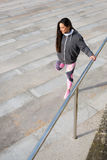 Fitness woman stretching legs before urban workout Stock Photography