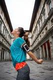 Fitness woman stretching near uffizi gallery Stock Photography