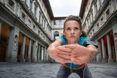 Fitness woman stretching near uffizi gallery Royalty Free Stock Images