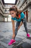 Fitness woman stretching near uffizi gallery Stock Image