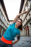 Fitness woman stretching near uffizi gallery in florence, italy Stock Photos