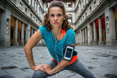 Fitness woman stretching near uffizi gallery in florence, italy Royalty Free Stock Photography