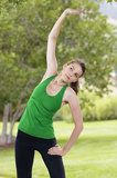 Fitness woman stretching outdoors Stock Photo