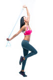 Fitness woman stretching with skipping rope Royalty Free Stock Photos