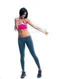 Fitness woman stretching with skipping rope Stock Photo