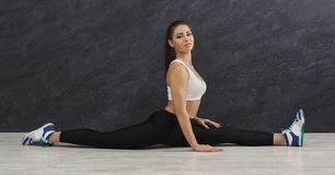 Fitness woman at stretching training indoors stock photography