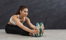 Fitness woman at stretching training indoors stock photo