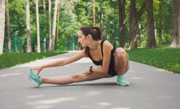 Fitness woman at stretching training outdoors Royalty Free Stock Images