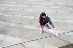 Fitness woman stretching before urban workout Royalty Free Stock Photography