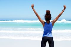 Fitness woman stretching workout at beach Royalty Free Stock Images
