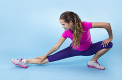 Fitness Woman stretching before a workout Stock Photos