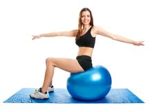 Fitness woman stretshing on fitness ball Stock Image