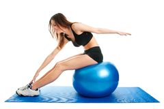 Fitness woman stretshing on fitness ball Stock Photo