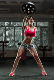 Fitness woman swinging kettle bell at gym Royalty Free Stock Photo