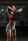 Fitness woman swinging kettle bell at gym Royalty Free Stock Photography