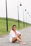 Fitness woman taking a workout rest outdoor Royalty Free Stock Images