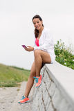 Fitness woman taking a workout rest outdoor Stock Image
