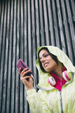 Fitness woman texting on smartphone Stock Photos