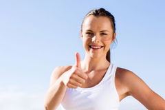 Fitness woman thumb up. Beautiful young fitness woman giving thumb up Stock Images
