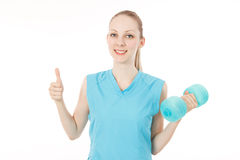 Fitness woman to make a finger stock photos