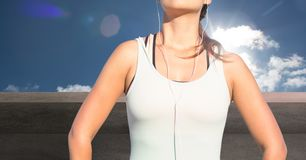 Fitness woman Torso listening music against countryside background Stock Images