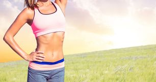 Fitness woman Torso making exercises against countryside background Royalty Free Stock Photo
