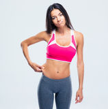 Fitness woman touching her belly fat Stock Photos