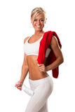 Fitness woman with towel around her shoulder Royalty Free Stock Images