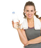 Fitness woman with towel and bottle of water Royalty Free Stock Photo
