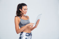 Fitness woman with towel showing thumbs up Royalty Free Stock Photo