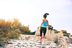 Fitness woman trail runner running at chinese great wall Royalty Free Stock Images