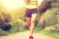 Fitness woman trail runner running on trail Royalty Free Stock Photography