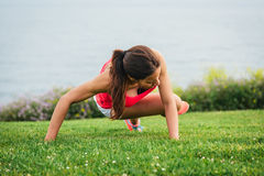 Fitness woman training core outdoor Stock Photo