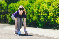 Fitness woman training and jogging in summer park near forest. Ready to start. Healthy lifestyle and sport concept Royalty Free Stock Image