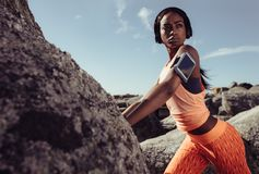 Fitness woman during training session outdoors. Royalty Free Stock Photo