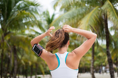 Fitness woman tying ponytail for working out Royalty Free Stock Photo