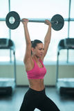 Fitness Woman Using Barbell Exercising Shoulders Inside Gym Stock Photos