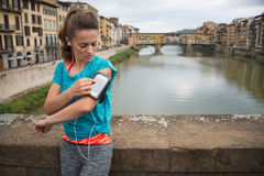 Fitness woman using cell phone in front of ponte vecchio in flor Royalty Free Stock Image