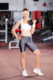 Fitness woman using dumbbell Royalty Free Stock Photo