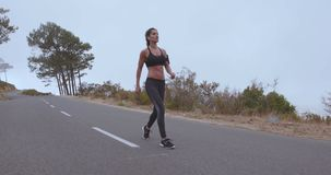 Fitness woman walking on country road. stock footage