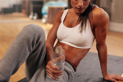 Fitness woman with water bottle at gym Royalty Free Stock Images